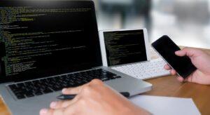 HEADER-bigstock--developer-Team-Working-Laptop-172492532