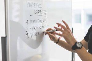 HEADER-marketing-expert-explaining-new-marketing-strategy-to-coworkers-picjumbo-com