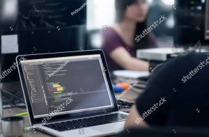 stock-photo-asian-outsource-developer-team-sitting-at-desk-working-laptop-computer-mobile-application-software-407008072