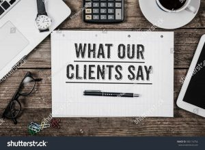 stock-photo-what-our-clients-say-statement-on-paper-note-pad-office-desk-with-electronic-devices-and-computer-582114754